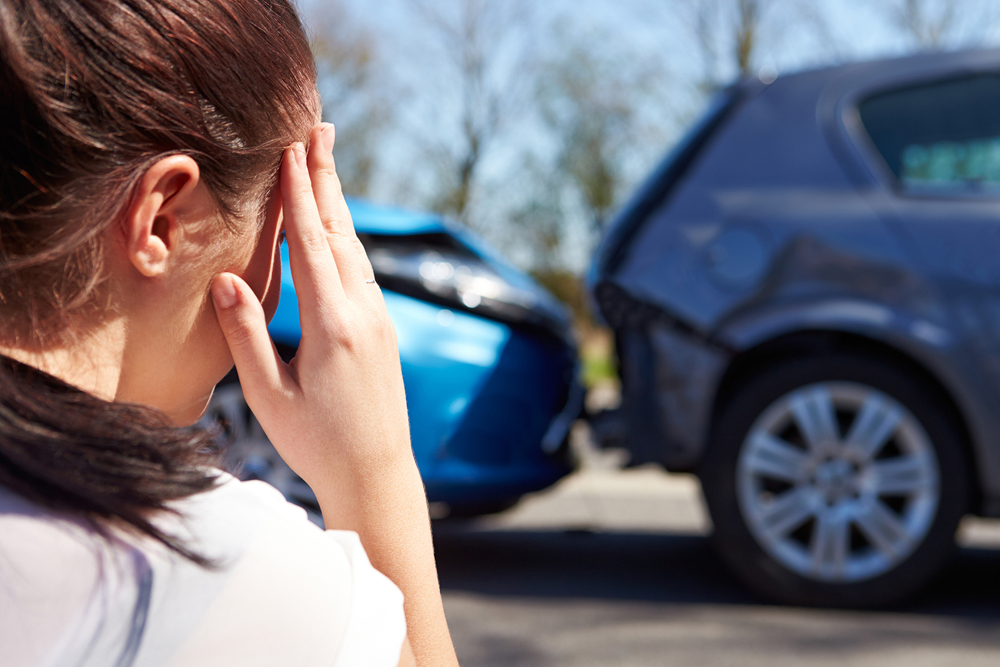 Woman suffering from a head injury from auto accident